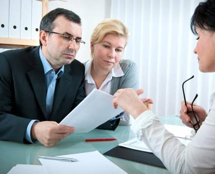 Couple discussing tax management with a specialist