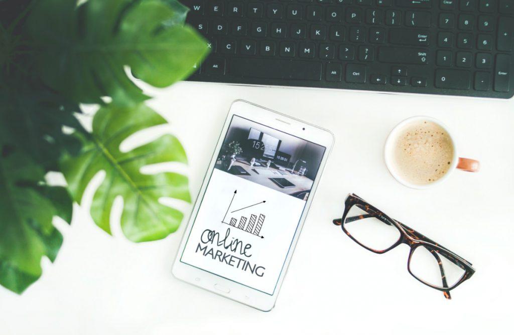 tablet displaying online marketing for profit management